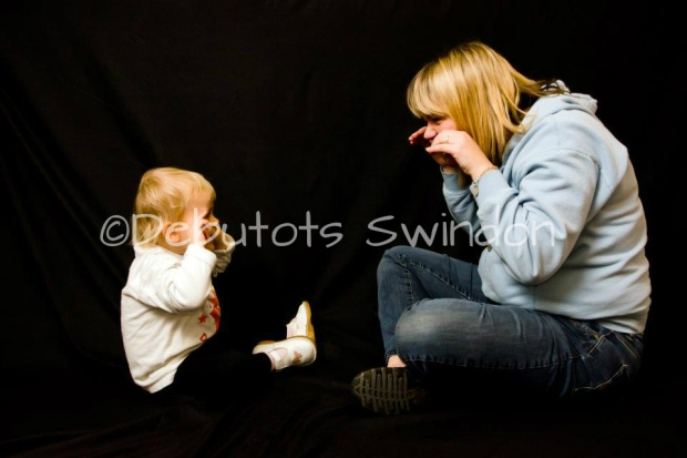 Jenni working with a toddler making a Squeaky Mouse